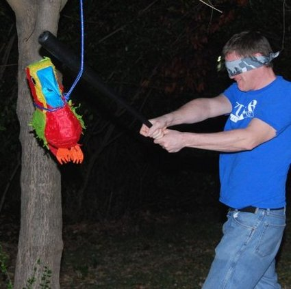 Your author beating the crap out of a helpless pinata